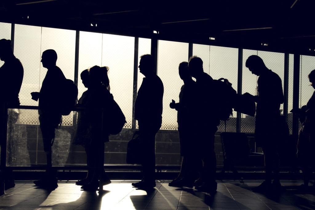 People Waiting to Board Flight