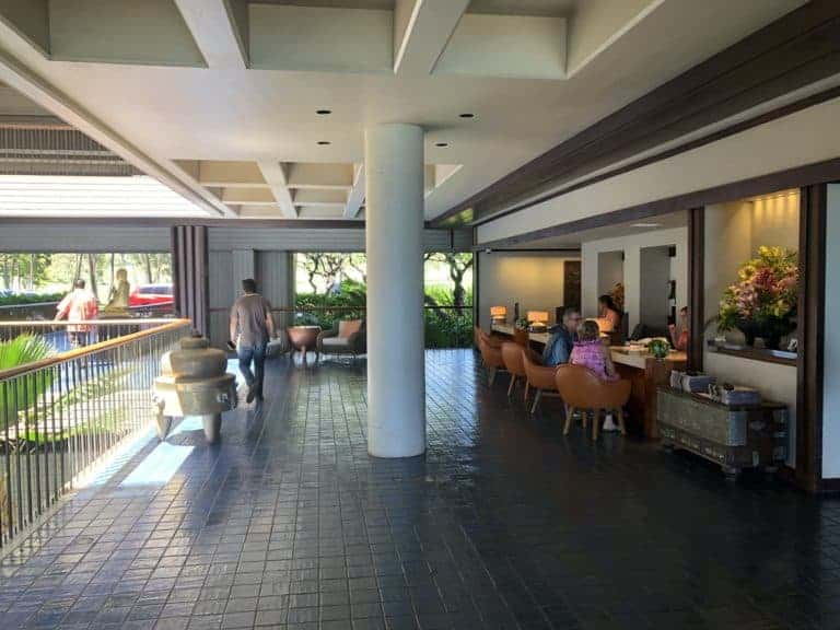 checking in at the desk in the open-air lobby of Mauna Kean Beach Hotel