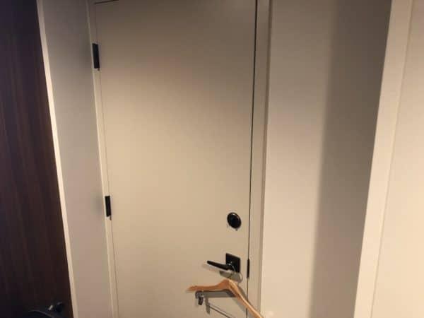 A metal door between hotel rooms - Disney's Coronado Springs Resort