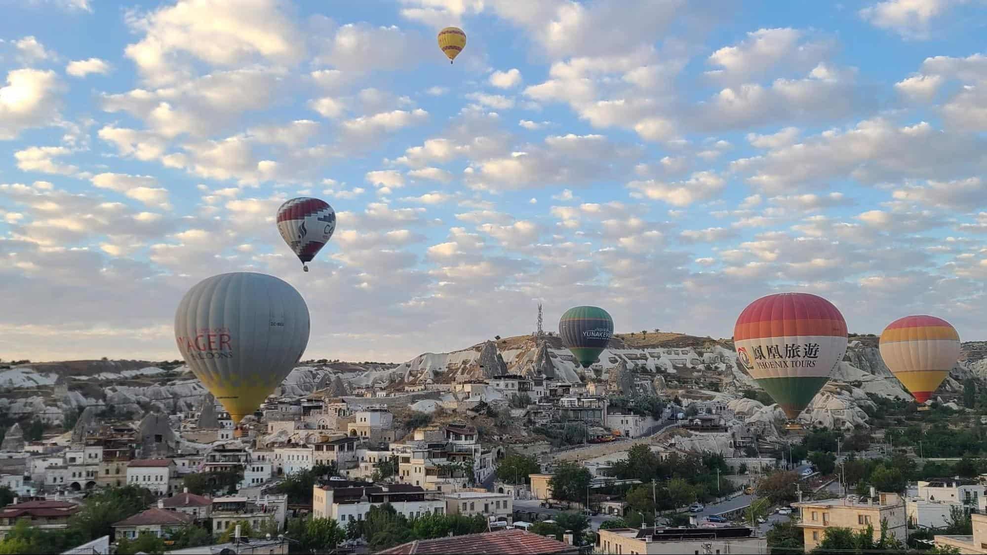Hot air balloons soar above Goreme, Cappadocia