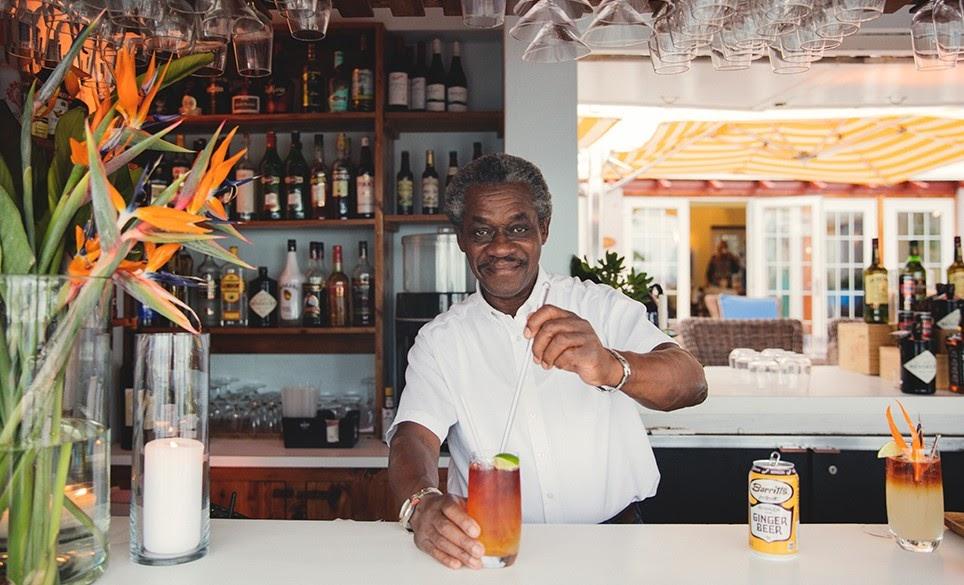 weekend getaways to Bermuda - dark n stormy bar bartendar local cocktail