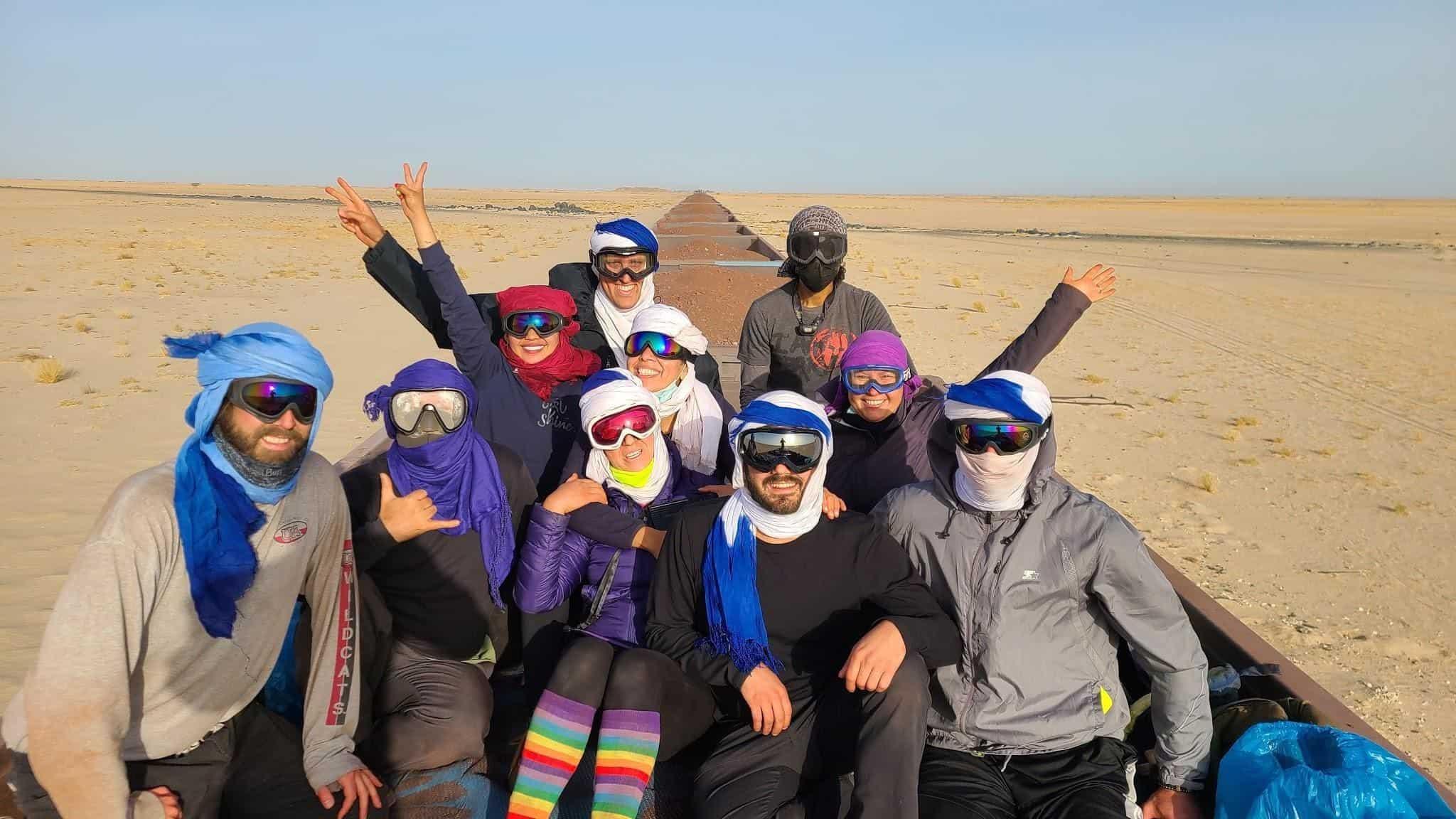 A group of adventurers rides the iron ore train from Choum to Nouadhibou, Mauritania.
